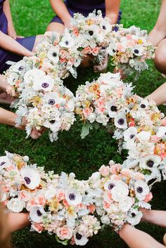 Last name initial made with bridesmaid bouquets... love the idea and the flowers!