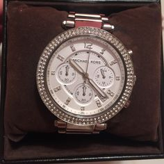 Michael Kors Silver Watch Silver MK watch with crystals around the face. Extra links Michael Kors Jewelry