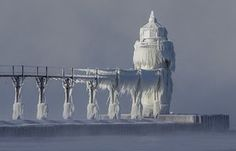 Extreme cold conditions cause ice accretions to cover the St. Joseph lighthouse and pier, on the southeastern shoreline of Lake Michigan, US Eyewitness: St Joseph, US | World news | The Guardian