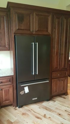 Lg black stainless steel appliances on display for Dark brown kitchen cabinets with stainless steel appliances