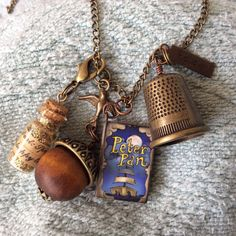 Peter Pan Necklace by LowcountryEclectic, $30.00  thimble, acorn, pixie dust, Wendy bird--perfect!