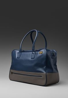 I'm into this G-Star Men's Sports bag, cute with some navy colored flats, it's sleek but casual and super cute. Could hold your life and all your baggage inside.