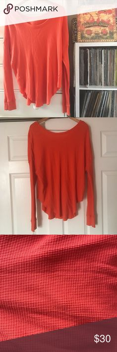"""FP Favorite! Thermal 🍑 Free People  Sunset 🌅 park Thermal  Size large  Orange  Measurements laying flat  Bust 25.5 Waist 24"""" Length 32"""" Oversized fit  Stretches  Very Good preowned condition 7/10. Shows some wear on front. Pilling on sleeve cuffs. See pics. Has a lot of life left Free People Tops Tees - Long Sleeve"""