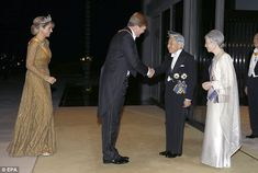 Glittering: Queen Maxima opted for an opulent gold gown which she wore with her royal sash and tiara for the State Dinner in Tokyo, 29 October 2014. Here she and King Willem Alexander are greeted by Emperor Akihito and Empress Michako.