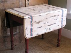Drop Leaf Table - love the numbers and maybe the stripe, not to big on the distressing across the top though