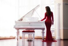 Woman Playing Piano | Lady in red dress playing piano | A collection of dresses for you