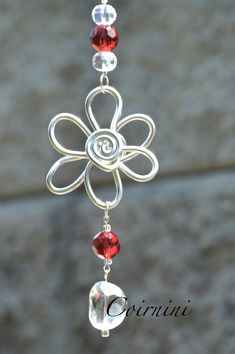 Suncatchers - Sunjewels - In this photo: Garden Pot Suncatchers. Intricate silver wire suncatchers, with reflective beads. You choose the bead colours and your choice of silver or copper wire ~ I will create it. Place your suncatcher in that perfect room you love. Visit us at www.facebook.com/coirninico - Coirnini Company © ™ Pam Potts
