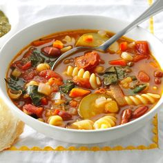 Over-the-Rainbow Minestrone Recipe -This colorful soup is vegetarian-friendly and full of fresh flavors from a rainbow of vegetables. You can use any multi-colored pasta in place of the rotini. —Crystal Schlueter, Northglenn, Colorado