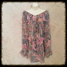 Victoria's Secret blouse Semi-sheer 100% polyester top with beautiful flowers and flowing ruffles.  Small pearl button closure at neckline - excellent condition. Looks great with jeans, leggings, or a long, fitted skirt. Size medium. Victoria's Secret Tops Blouses