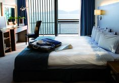 This luxurious Presidential Suite of Domotel Xenia Volos is 61 sqm and provides 1 bedroom, 1 living room, 1 dining room, 1 bathroom with shower, jacuzzi and a terrace with sea view. Outdoor Pool, Outdoor Decor, Whirlpool Bathtub, At The Hotel, Jacuzzi, Front Desk, Indoor, Living Room, Bedroom