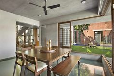 Ajay Patel Residence | Dipen Gada & Associates Courtyard House Plans, Courtyard Design, Indian Home Design, Indian Home Decor, Hall Interior, Home Interior Design, Kota Stone Flooring, Minimal House Design, Bungalow Interiors