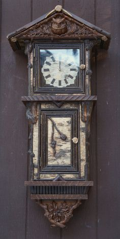 Carved in oak by Jillian, this wall clock pays tribute to the Eastern Screech Owl.