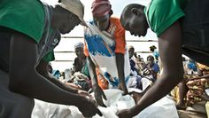 Oxfam distributes WFP food at Mingkaman where 58,000 people forced from their homes have arrived in search of food, water and safety from th...