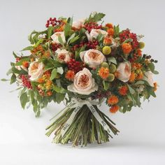 Each month we celebrate the best in seasonal flowers and create a bouquet using a selection of our favourite flowers for the time of year. As the seasons gently roll on, our September bouquet embraces the colours and warmth of an Indian summer – peach roses, yellow craspidia, orange viburnum carthemus, blackberries and seasonal foliage.