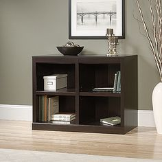 Two adjustable shelves. Quick and easy assembly with patented slide-on moldings. Jamocha Wood finish.