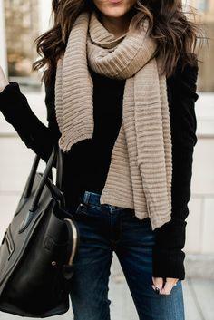 Black sweater and beige blanket scarf