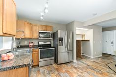 This Aurora townhouse kitchen features stainless steel appliances with plenty of storage