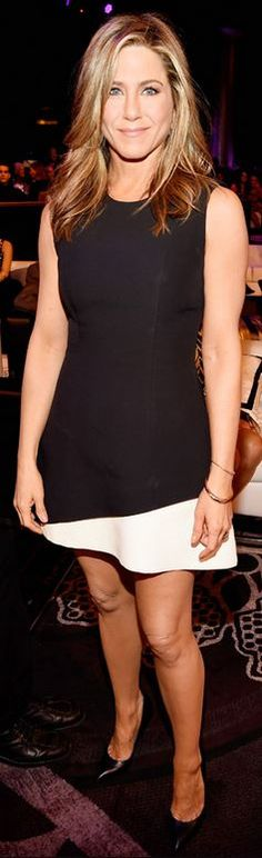 Who made Jennifer Aniston's white ruffle dress and black pumps that she wore in Beverly Hills on December 18, 2014?
