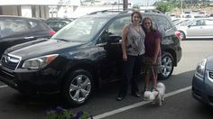 The Williams family with their new 2014 Subaru Forester Touring SUV! Sold by Jim Gamble.