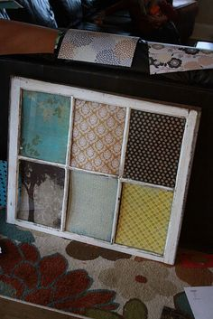 Old window with scrapbook paper.  Now hanging in our bedroom.