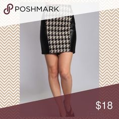Faux leather houndstooth mini skirt Mini pencil style skirt features houndstooth print in front and back with faux leather sides. Skirts