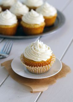 Coconut Cupcakes with White Chocolate Cream Cheese Frosting (and they're stuffed with a truffle!) | Bakerita.com