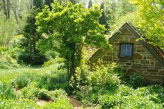 The pump house for the ponds set amongst the shrubbery. Chanticleer, US