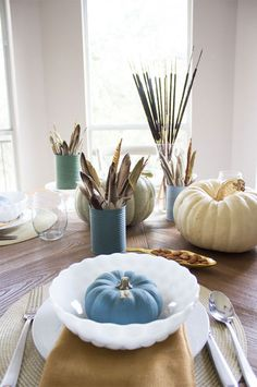 Paint pumpkins in calm, neutral colors to serve as table setting place cards.
