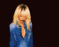 Rihanna, blonde hair w/ black roots, jean jumpsuit