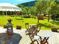 Tree-filled garden with  beautiful view on the surrounding mountains at BLUETS ET BRIMBELLES Bed and Breakfast in Alsace