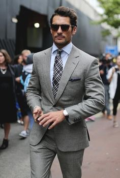 David Gandy in a crisp suit combo with a gray suit plaid tie white shirt and dark gray pocket square with a pair of sunglasses #davidgandy #suit #mensfashion #menswear #menstyle #celebrities #celebrity