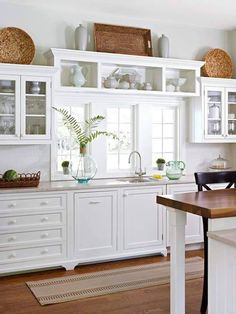 white on white kitchen, drawer pulls, straw baskets for color, interest & homey feel, same color on bar countertop