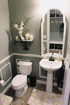 Grab a little bit of paint, upcycle an older mirror and add some faux wainscoating with a chair rail. More Remodeled Bathroom Ideas . Small Bathroom Ideas On A Budget Bad Inspiration, Bathroom Inspiration, Mirror Inspiration, Grey Bathrooms, Beautiful Bathrooms, White Bathroom, Bathroom Colors, Pedastal Sink Bathroom, Bathroom Small