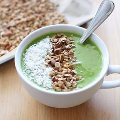 Green smoothie bowl with homemade granola