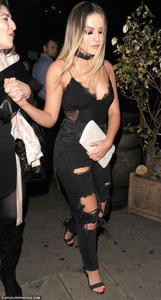 All black everything: Little Mix stars Perrie Edwards and Leigh-Anne Pinnock were naturally keen to celebrate as they headed out to Bodo's Schloss in Kensington on Saturday night before leaving it up to the early hours