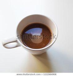 Coffee drink in white mug. Light background.