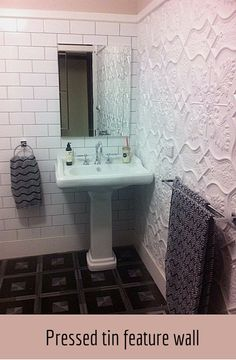 This is a bathroom feature wall created by using the Shield pressed tin panels design.  Panels are a cost effective way to give a room an uplift plus they are easy to install. For more photos of this project see: http://www.heritageceilings.com.au/clients-projects/macklin-pressed-tin-feature-wall.php