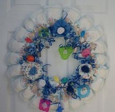 Baby shower wreath/ how to make wreath with coat hanger, will turn to hang like mobile