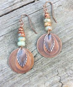 """Antiqued copper discs with a small feather drop accent and African opals. Very light weight and perfect colors for your fall wardrobe! Approx 2"""" in total hanging length."""