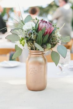 How To Use Mason Jar On Your Wedding Day - get a clear mason jar and paint it with gold paint! Alternatively, you can purchase gold mercury mason jars instead if DIY is not your thing! Gold Mason Jars, Painted Mason Jars, Beach Wedding Reception, Diy Wedding, Wedding Ideas, Wedding Tables, Wedding Details, Wedding Stuff, Dream Wedding