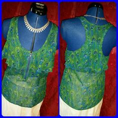 """Dressy peacock print tank Beautiful colored peacock print dressy tank. Front zipper and a single ruffle layer around bust and racer back. 100% polyester Bust measures 18"""" across. Very good pre-loved condition. Ali & Kris Tops Tank Tops"""