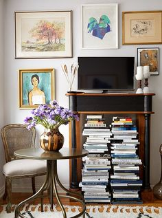 A vintage bistro table serves as Ari's worktable, dinner surface, and bar when hosting friends; Anthony brought inan ornate wood mantel that elevates theTVwhile holdingAri's books.