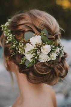 Flower crowns are a winning 2017 wedding hair accessory. #weddingmakeup