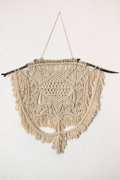 Handmade Medium Sized Macrame Wall Hanging This boho piece is custom made with natural unbleached cotton rope on beautiful hand picked driftwood. Trimmed with fringe and made with love, its the perfect accent for any room! Height is 32.5 inches with the string however can be