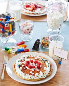 Kid-friendly brunch: Jars filled with Legos keep little (and big) hands occupied at the table. Lego mini figurines stand in as place card holders. More holiday party ideas:  http://www.midwestliving.com/holidays/christmas/5-christmas-party-ideas/?page=6
