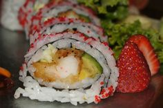 Mumon Roll: lobster tempura, avocado and cucumber inside. It is topped with tobiko and served with a soy mustard vinaigrette.