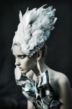 Feathered headress. White swan-esque.