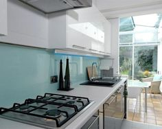 photo of contemporary future blue mint teal white conservatory kitchen