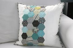 Cute hexie pillow in aqua and grey.