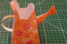 Paper Watering Can Tutorial by Helen Orr: Fun to fill up with treats as party favors in Springtime, or for Easter / Split Coast Stampers